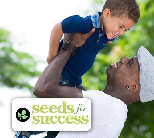 Photo of father and son with Seeds for Success logo