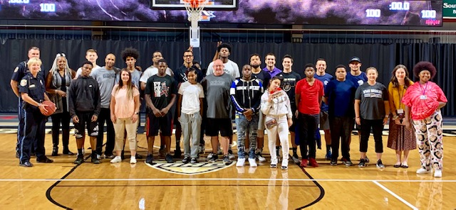 Bridging Opportunities participants pose on the WMU basketball courts during a tour of the facility