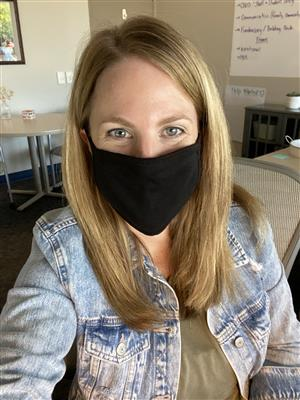 Karen Rangler, principal at YAP, smiles while wearing a mask