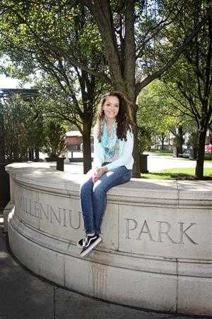 Lily Hall poses for a picture in the park