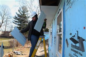 CTE Construction Trades student builds a house with Habitat for Humanity.