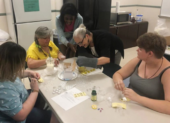 YOU participants craft homemade candles with their mentor.