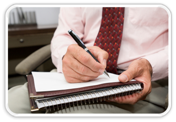 Photo of man writing on notepad