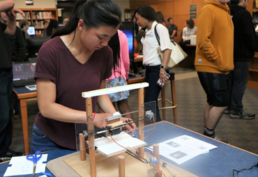 Kim Chheu works on her 2D printer