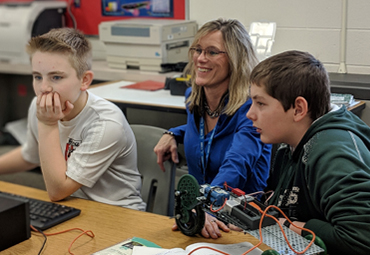 Students and instructor in PLTW class at Vicksburg Middle School