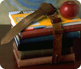 Schoolbooks and apple photo