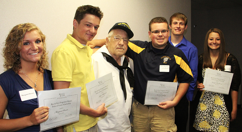 Francis Max Smith with five of the 9 student scholarship recipients